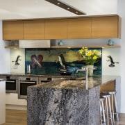 In this waterfront home, the kitchen splashback comprises countertop, floor, interior design, kitchen, room, white