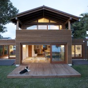 Coastal connections this house by Richard Middleton opens architecture, backyard, cottage, estate, facade, home, house, property, real estate, residential area, siding, teal