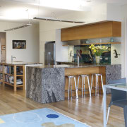 The open-plan dining and kitchen area in this floor, flooring, house, interior design, real estate, room, table, gray
