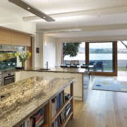 The interiors of this modern seaside house feature countertop, estate, house, interior design, kitchen, real estate, gray