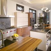 The dramatic grain in the zebrano wood in cabinetry, countertop, cuisine classique, home, interior design, kitchen, real estate, room, gray