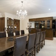 Solid wood furniture and studded leather chairs bring ceiling, dining room, estate, interior design, property, real estate, room, table, gray