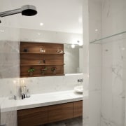The shower in this bathroom incorporates a rainshower bathroom, floor, home, interior design, room, sink, tap, tile, gray