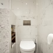 Walnut shelves feature in a niche in a bathroom, bidet, ceramic, floor, interior design, plumbing fixture, product design, room, sink, tap, tile, toilet, toilet seat, wall, gray