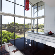 The dark timber floor, stainless benches and white architecture, home, house, interior design, table, window, white