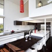 The dark timber floor, stainless benches and white architecture, countertop, furniture, house, interior design, kitchen, table, gray, white