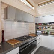 Kitchen designer Irene James avoided the use of countertop, interior design, kitchen, gray
