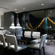 Walls in this contemporary New Farm penthouse are dining room, interior design, restaurant, black, gray