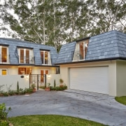 Tucked beneath a towering gum tree canopy, this cottage, elevation, estate, facade, home, house, property, real estate, residential area, siding, gray, brown