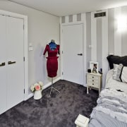 Tucked beneath a towering gum tree canopy, this bedroom, floor, flooring, home, interior design, real estate, room, gray