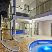 Tucked beneath a towering gum tree canopy, this apartment, architecture, condominium, estate, floor, home, house, interior design, property, real estate, swimming pool, gray