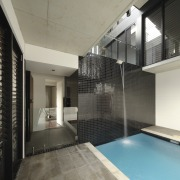 This plunge pool on the second level of apartment, architecture, ceiling, daylighting, estate, floor, glass, house, interior design, property, real estate, window, gray, black