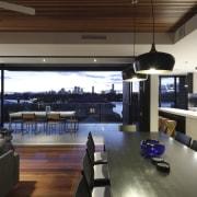 Designed by Natalie Dixon and Kon Panagopoulos of interior design, living room, black