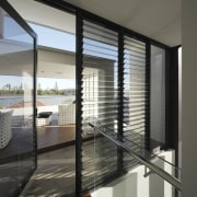 An internal staircase leads to the roof deck architecture, condominium, daylighting, door, glass, house, interior design, real estate, window, window blind, window covering, window treatment, gray, black