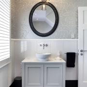 The vanity in the guest bathroom is painted bathroom, bathroom accessory, bathroom cabinet, bathroom sink, floor, flooring, home, interior design, plumbing fixture, product design, room, sink, tap, gray