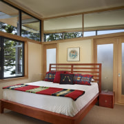 The master bedroom in this waterfront house has architecture, bed frame, bedroom, ceiling, estate, home, interior design, real estate, room, window, wood, brown