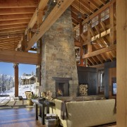Exposed rafters and beams ensure the architecture of beam, fireplace, hearth, home, interior design, living room, log cabin, wood, brown