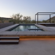 In this desert landscape, LED lights beneath the architecture, automotive exterior, daylighting, house, property, real estate, roof, swimming pool, gray
