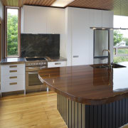Wood island top in kitchen renovation.Sixties revamp  architecture, cabinetry, countertop, daylighting, floor, flooring, furniture, hardwood, house, interior design, kitchen, laminate flooring, real estate, table, wood, wood flooring, wood stain, brown