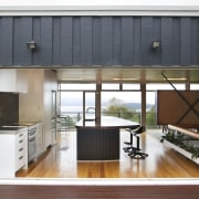 Large bifold doors open up this new kitchen architecture, door, home, house, interior design, real estate, window, wood, white