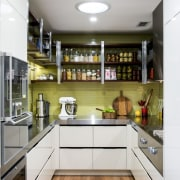 Open wood-and-metal shelving provides immediate access to this cabinetry, countertop, cuisine classique, interior design, kitchen, real estate, gray