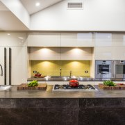 The backsplash in the kitchen and pantry is countertop, interior design, kitchen, living room, lobby, real estate, white