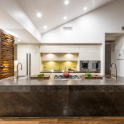 An angled front helps to soften and lighten countertop, interior design, kitchen, living room, white, brown