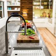 This kitchen has a Franke Peak sink with countertop, floor, flooring, interior design, kitchen, white
