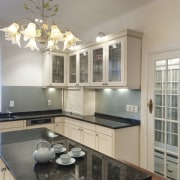 This Milvia Hannah kitchen melds with its surroundings. cabinetry, countertop, cuisine classique, home, interior design, kitchen, property, real estate, room, window, gray