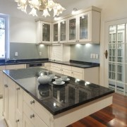 Finishes on the cabinet glass door fronts in cabinetry, countertop, cuisine classique, floor, flooring, hardwood, interior design, kitchen, real estate, room, wood flooring, gray