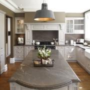 Doors, windows and floors were reconfigured to bring cabinetry, countertop, cuisine classique, floor, interior design, kitchen, room, white, gray