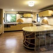 Nicola Cumming Design black and butterscotch kitchen cabinetry, countertop, cuisine classique, floor, flooring, hardwood, interior design, kitchen, real estate, room, wood flooring, brown, orange