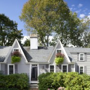 This Cape Cod-style residence was built in 1768, backyard, cottage, estate, facade, farmhouse, grass, historic house, home, house, landscaping, lawn, leaf, mansion, neighbourhood, outdoor structure, plant, plantation, property, real estate, residential area, roof, siding, sky, suburb, tree, yard, brown