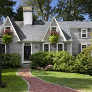 This Cape Cod-style residence was built in 1768, backyard, cottage, estate, farmhouse, historic house, home, house, landscape, landscaping, lawn, mansion, neighbourhood, outdoor structure, property, real estate, residential area, roof, siding, suburb, tree, window, yard, brown
