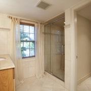 A toilet cubicle was added to the bathroom bathroom, estate, floor, flooring, home, interior design, property, real estate, room, window, orange, brown