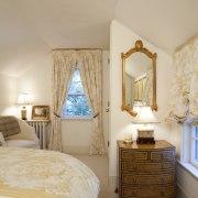 The guest bedroom in an extensively remodeled 1768 bed, bed frame, bedroom, ceiling, estate, floor, furniture, home, interior design, real estate, room, suite, wall, window, wood, orange