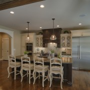 The new kitchen is designed for ease of ceiling, countertop, dining room, floor, flooring, hardwood, home, interior design, kitchen, real estate, room, table, wood flooring, brown, gray