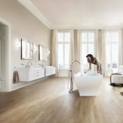 Its the absence of ornate detailing that enhances floor, flooring, furniture, hardwood, interior design, laminate flooring, living room, room, tile, window, wood, wood flooring, white