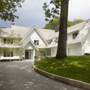 A prime lakefront setting and mature trees enhance building, cottage, estate, facade, farmhouse, grass, home, house, lawn, mansion, property, real estate, residential area, roof, suburb, tree, villa, window, brown, white