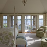 The master bedroom in this Cape Cod home ceiling, daylighting, estate, home, house, interior design, living room, real estate, room, window, window treatment, gray, brown