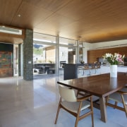 The interiors and furnishings  of this home architecture, ceiling, dining room, flooring, house, interior design, real estate, table, brown, gray
