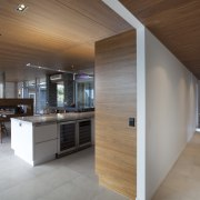 The interiors and furnishings  of this home architecture, ceiling, floor, flooring, hardwood, house, interior design, kitchen, real estate, wood, gray, brown