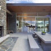 Above: An outdoor fireplace serves one of the architecture, estate, house, interior design, patio, real estate, gray