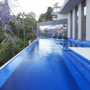 Contemporary outdoor area with infinity edge swimming pool estate, house, leisure, property, real estate, resort, swimming pool, water, blue
