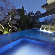 Contemporary outdoor area with infinity edge swimming pool architecture, estate, home, house, leisure, lighting, property, real estate, reflection, resort, resort town, swimming pool, villa, water, blue