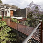 Suspended several metres above rock and a natural home, house, outdoor structure, plant, property, real estate, black