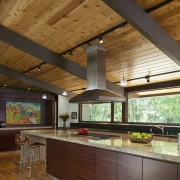 The new cabinetry in the kitchen of this architecture, beam, ceiling, countertop, daylighting, hardwood, house, interior design, kitchen, real estate, wood, brown