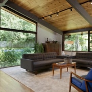 A family living area, positioned at the far architecture, ceiling, daylighting, estate, home, house, interior design, living room, real estate, roof, window, wood