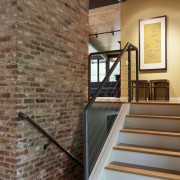 New wire balustrading is a feature of the architecture, brick, floor, flooring, handrail, hardwood, home, interior design, laminate flooring, stairs, wall, wood, wood flooring, wood stain, brown