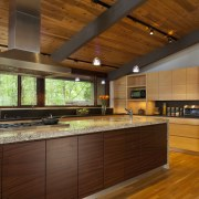 The new cabinetry in the kitchen of this architecture, cabinetry, ceiling, countertop, estate, flooring, hardwood, interior design, kitchen, real estate, wood, brown